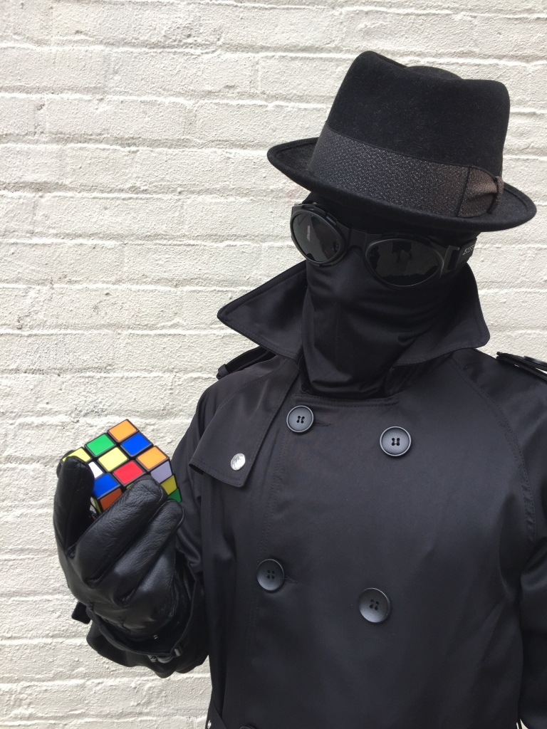 Noir Spiderman Into the Spiderverse costume with Rubik's cube.