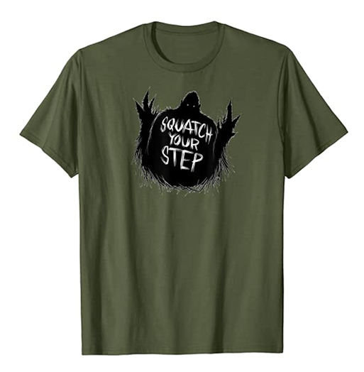 """the silhouette of Bigfoot surrounded by pine trees with the words """"Squatch your step"""""""